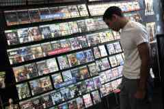 100427964-man-looking-at-video-games-store-getty.240x160
