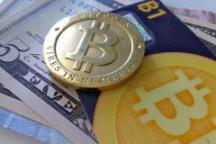 100630649-bitcoin-with-money-zach-copley-flickr.240x160