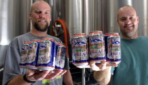 LYONS, COLO. - September 24, 2003 - Dale Katechis , left, owner, and Brian Lutz , brewmaster, hold freshly canned six-packs of Dale's Pale Ale  in the brew house of Oskar Blues Brewery  in Lyons, CO Wednesday afternoon, 9/24/03. Packaging